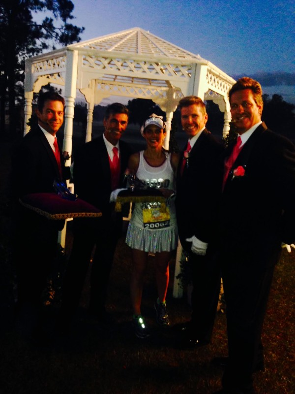 Posing with a glass slipper and the men at the wedding chapel near Disney's Grand Floridian